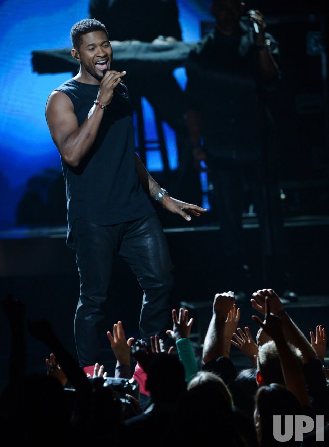 Usher performs during BET Awards 12 in Los Angeles