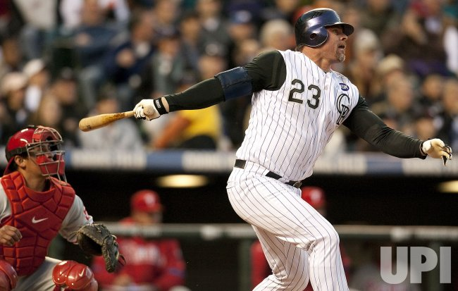 Rockies Giambi Bats in a Run Against the Phillies in Denver