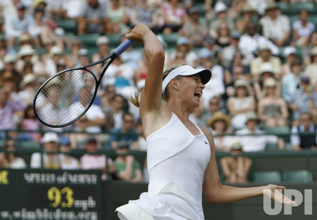 Russia's Maria Sharapova plays against Czech Barbora Zahlavova Strycova at the Wimbledon Championships