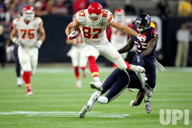 Chiefs tight end Travis Kelce leaps over Joseph