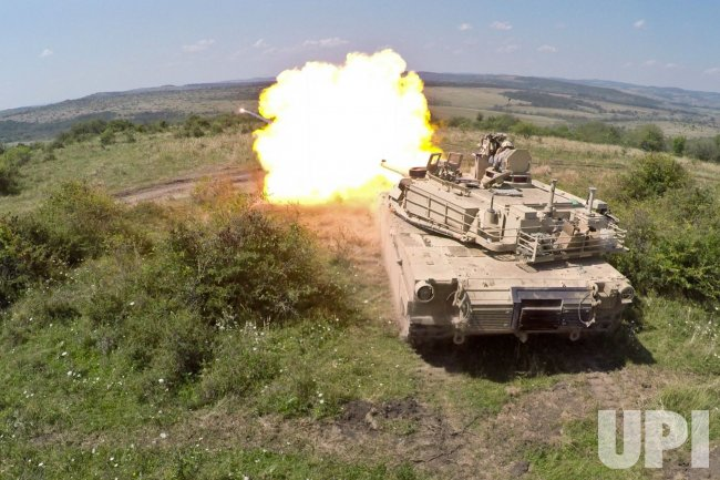 Blast from an M1A2 Abrams tank during live fire exercise as part of Saber Guardian
