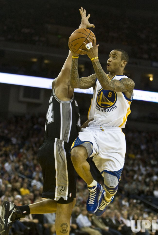 Warriors Monta Ellis shoots in loss to the San Antonio Spurs in Oakland, California