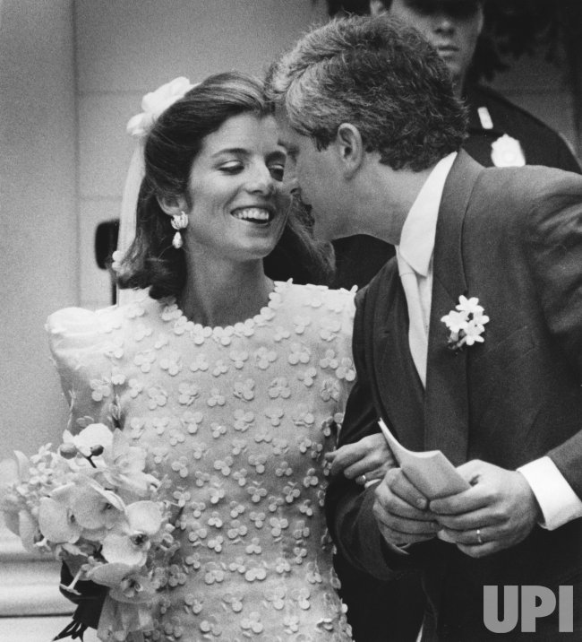 Caroline Kennedy and Edwin Schlossberg kiss on their wedding day