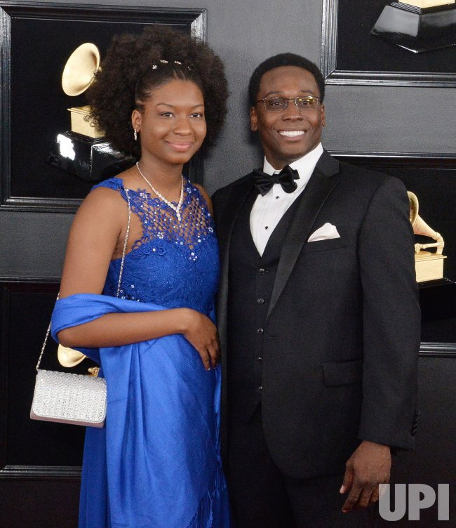 Dr. Jeffery Redding (R) and guest arrive for the 61st Grammy Awards in Los Angeles