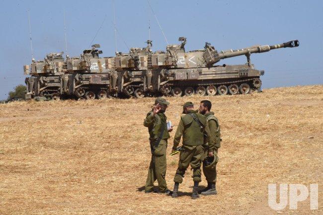 Israeli Soldiers Speak Near Artillery Batteries On The Israel-Gaza Border