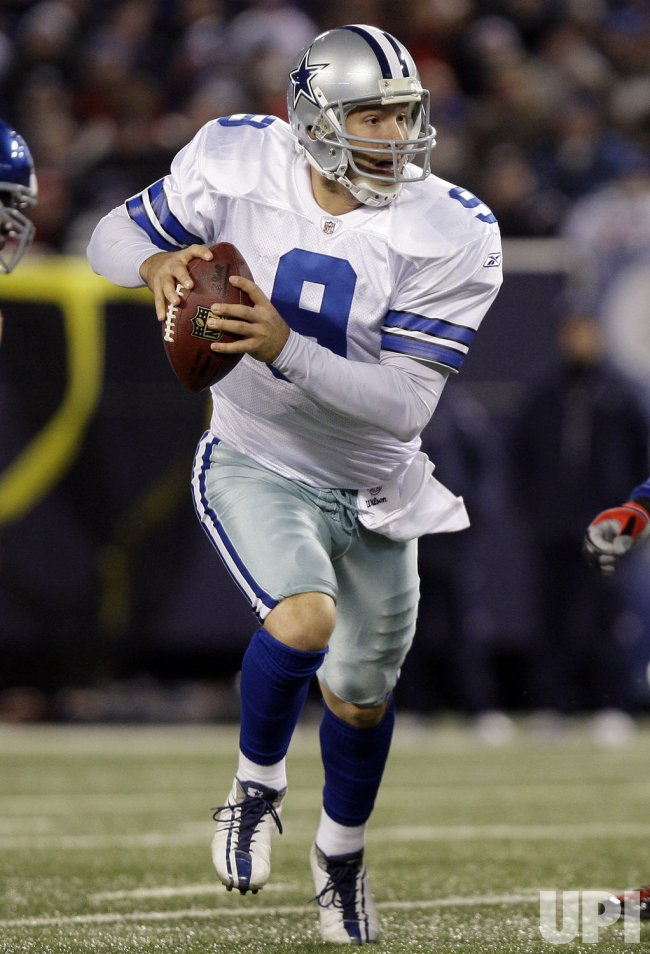 Dallas Cowboys Tony Romo runs out of the pocket in the first quarter against the New York Giants in week 13 of the NFL season at Giants Stadium