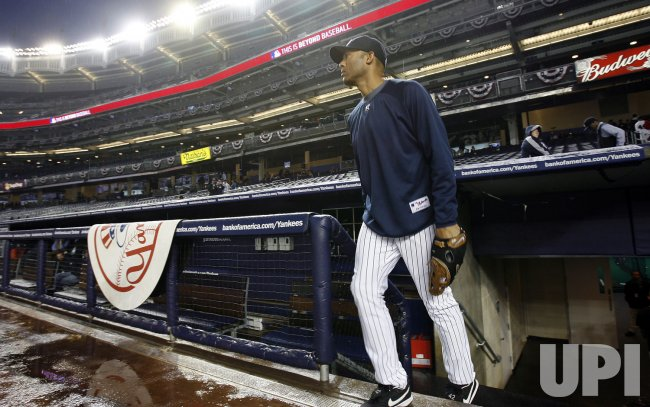 New York Yankees Mariano Rivera walks on to the field moments after game 6 of the ALCS between the New York Yankees and the Los Angeles Angels of Anaheim is postponed due to rain at Yankee Stadium in New York