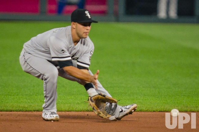 White Sox Nick Madrigal Throws Out a Runner at First Base