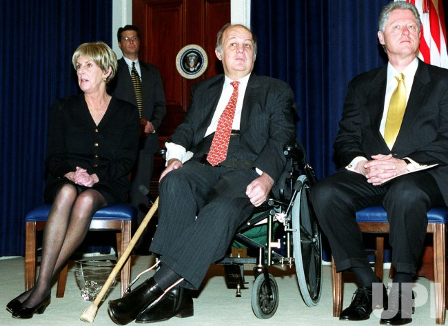 President Clinton share a laugh with Jim Brady