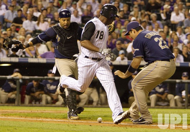 Padres Torrealba and Gonzalez Chase Bunt Attempt by Rockies Herrera in Denver