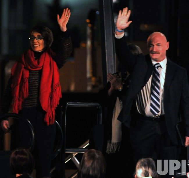 Giffords and Kelly wave to crowd at the vigil for the anniversary of the shootings in Tucson, Arizona.