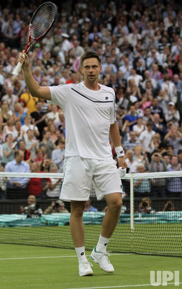 Robin Soderling acknowledges crowd at Wimbledon.