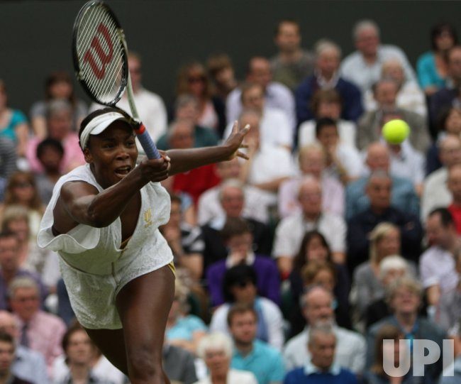 Venus Williams returns at Wimbledon.