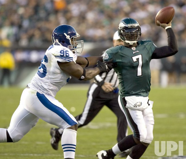 Philadelphia Eagles quareterback Michael Vick passes under pressure