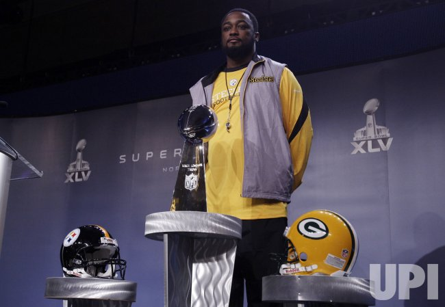 Pittsburgh Steelers Head Coach Mike Tomlin stands next to the Vince Lombardi Trophy at a Press Conference in Dallas