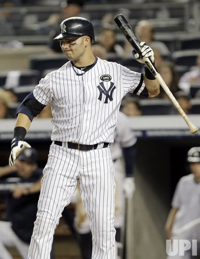 New York Yankees Nick Swisher reacts at Yankee Stadium in New York