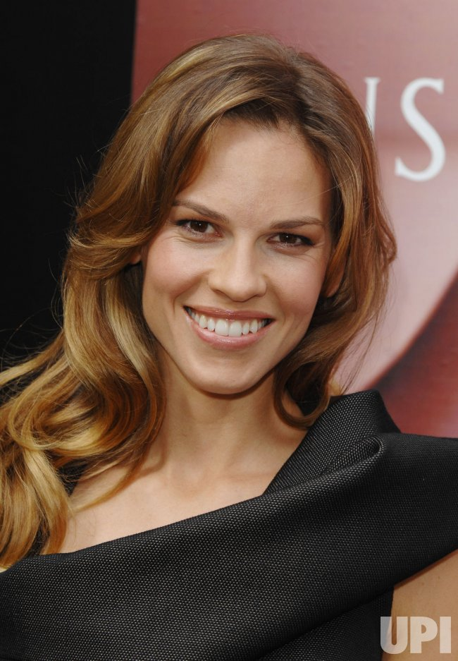 """HILARY SWANK PROMOTES GUERLAIN'S PERFUME """"INSOLENCE"""" IN LONDON"""