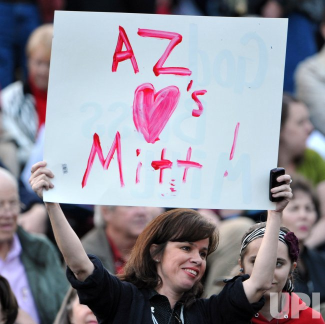 Woman holds sign for Mitt Romney in Mesa, Arizona.