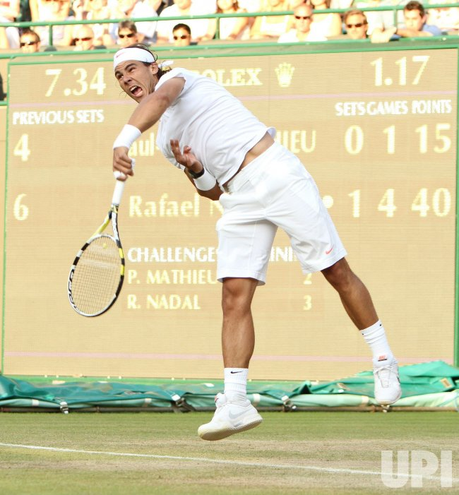 Nadal serves at the Wimbledon Championships