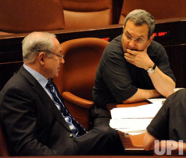 Israeli Prime Minister Benjamin Netanyahu and Defense Minister Ehud Barak talk in the Knesset in Jerusalem
