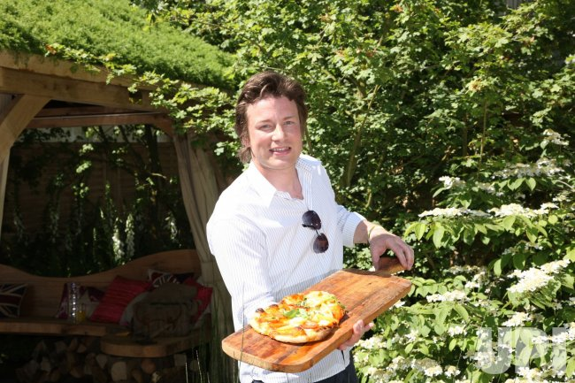 Chef Jamie Oliver cooks pizza at Chelsea Flower Show