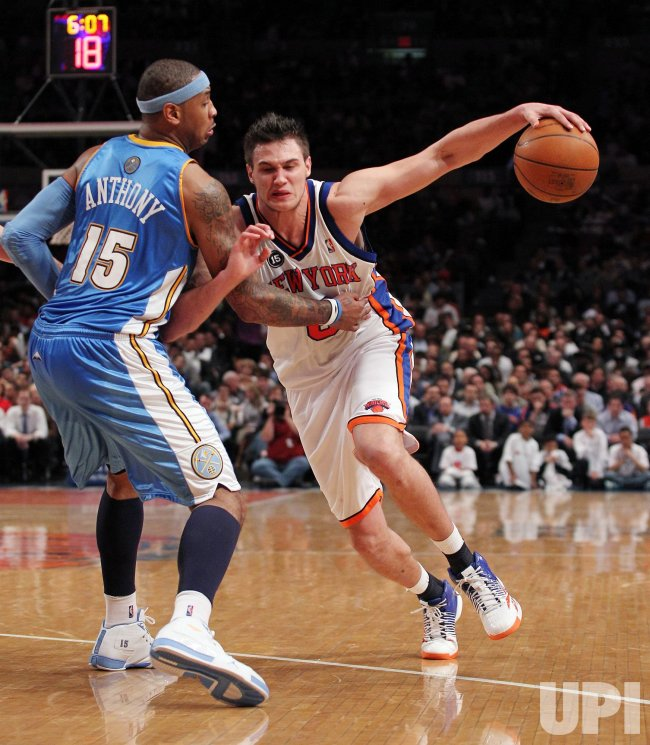New York Knicks Danilo Gallinari drives into Denver Nuggets Carmelo Anthony at Madison Square Garden