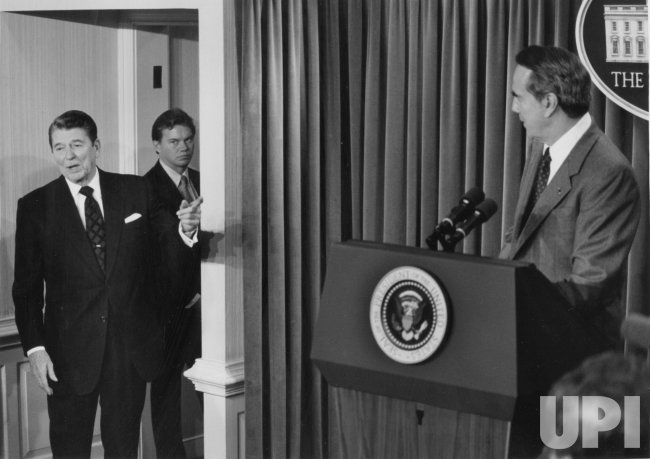 President Reagan Points to Bob Dole During News Conference
