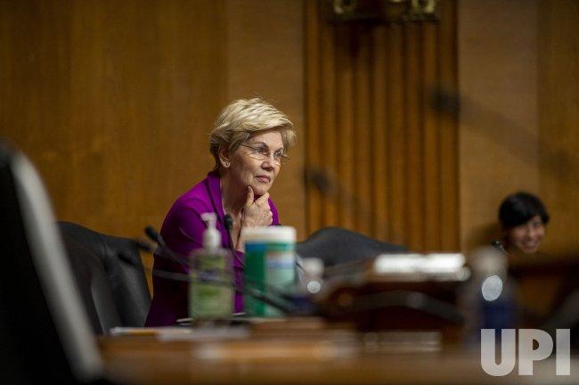 Elizabeth Warren waits to speak in Washington DC