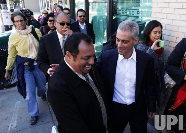 Emanuel walks with Rangel through Chicago neighborhood