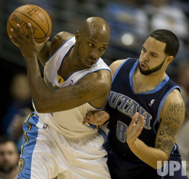 Nuggets Billups Moves Against Jazz Williams in Denver