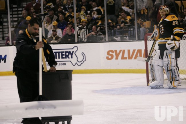 Bruins Rask looks down during break against Flyers in Game 5 of the NHL Eastern Conference Semi-Final in Boston, MA.