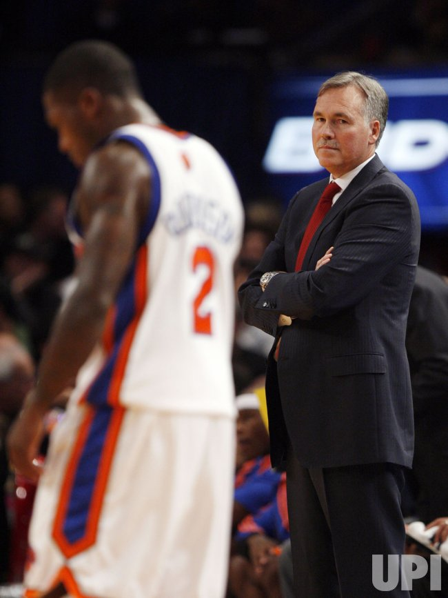 New York Knicks Head Coach Mike D'Antoni looks at Nate Robinson in a preseason game against the Philadelphia 76ers at Madison Square Garden in New York City