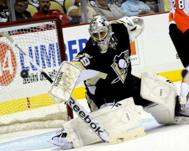 Pittsburgh Penguins Fleury Clears Puck Away from Goal in Pittsburgh