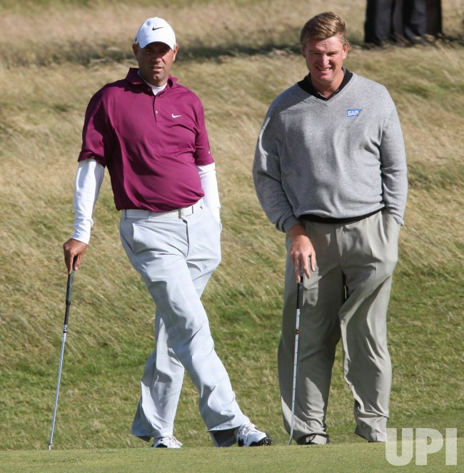 Cink and Els laugh on the second day of the Open championship.