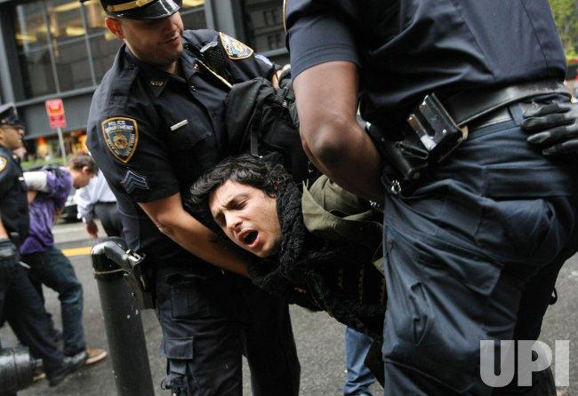Demonstrators march on Wall Street in New York