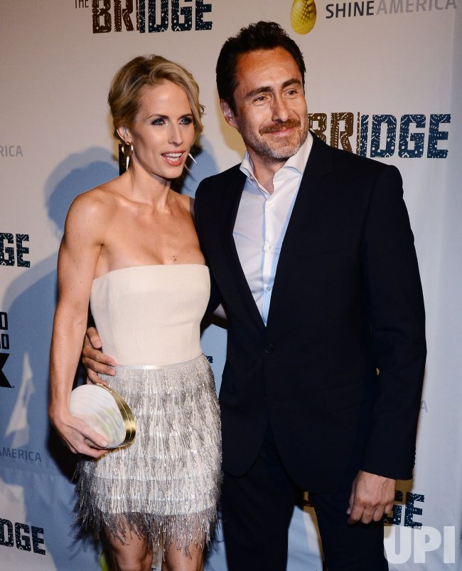 "Demian Bichir and Stefanie Sherk attend the FX series premiere of ""The Bridge"" in Los Angeles"