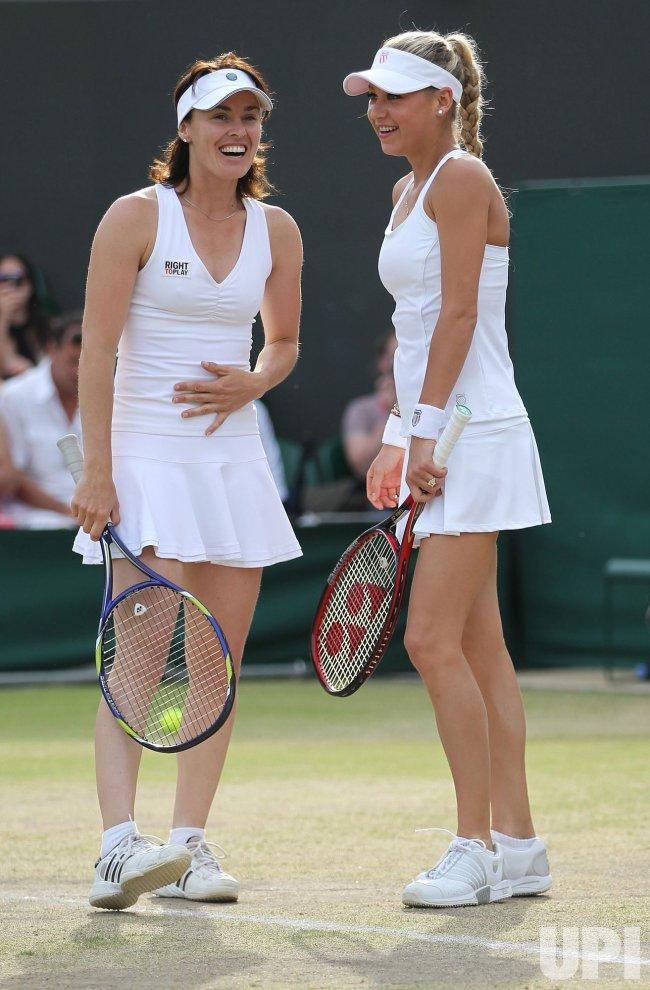 Kournikova and Hingis laugh at the Wimbledon Championships