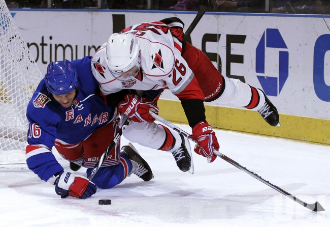 Carolina Hurricanes Erik Cole and New York Rangers Sean Avery dive for a lose puck at Madison Square Garden in New York