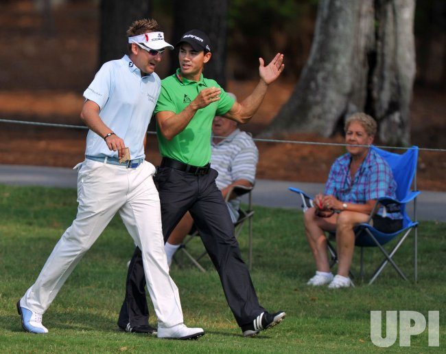 Ian Poulter and Camilo Villegas conversation during the TPC Players in Florida