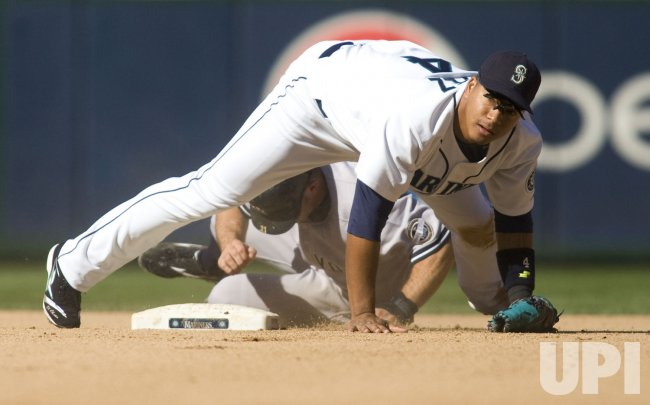 Seattle Mariners second baseman Jose Lopez turns a double play aganst the New York Yankees.