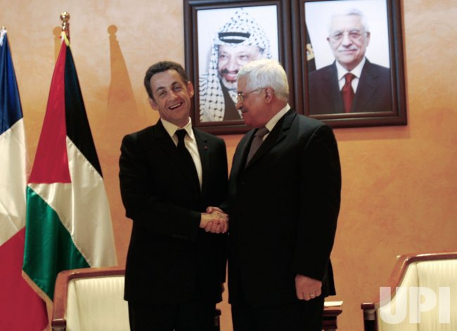 France's President Sarkozy shakes hands with Palestinian President Abbas in Bethlehem