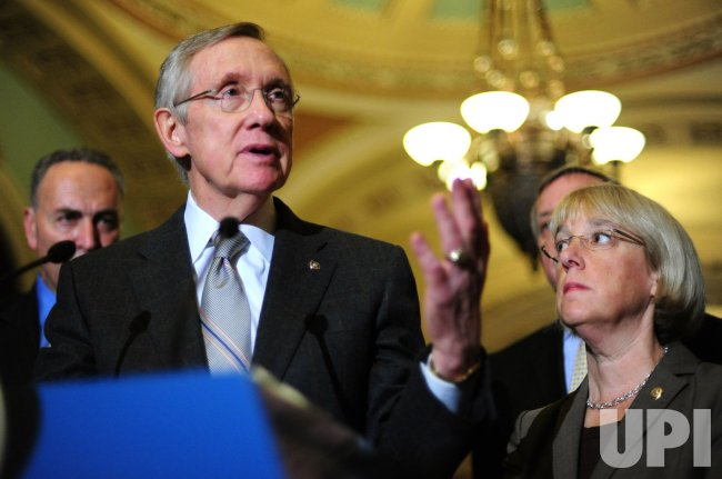 Senate Majority Leader Harry Reid speaks on the passage of the debt limit increase in Washington