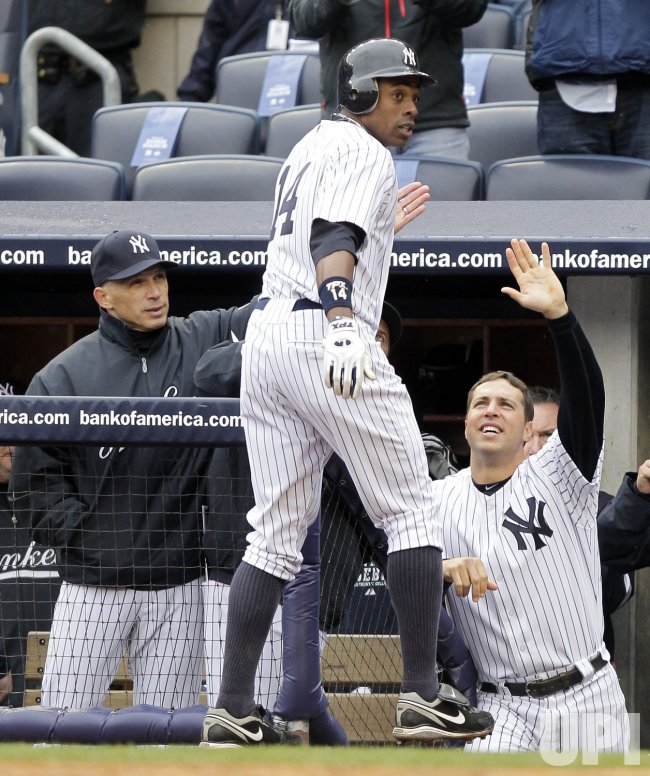 New York Yankees Manager Joe Girardi, Curtis Granderson and Mark Teixeira on Opening Day at Yankee Stadium in New York
