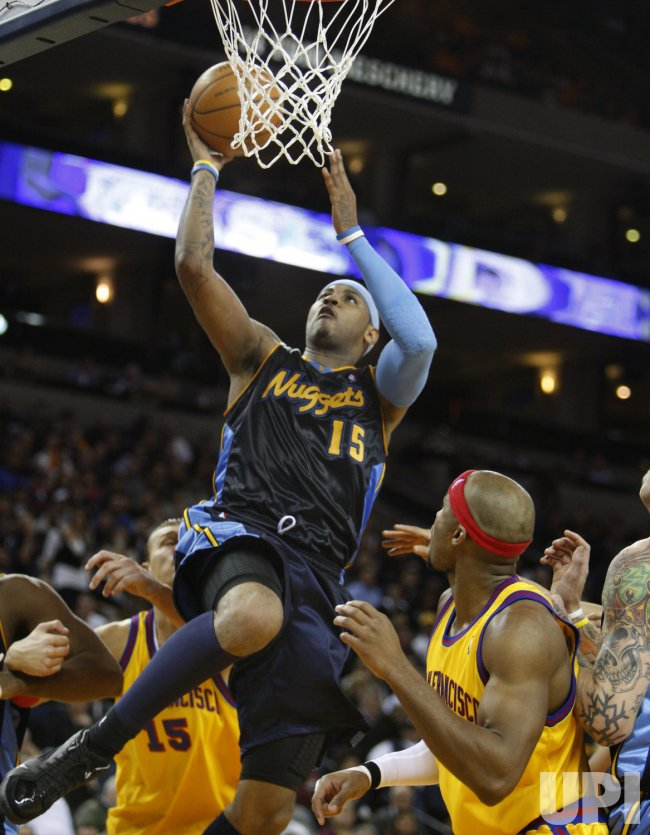 Denver Nuggets Carmelo Anthony scores in defeat of Warriors in Oakland, California