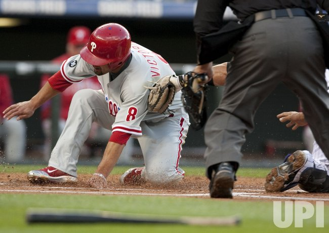 Phillies Victorino Scores Against the Rockies in Denver