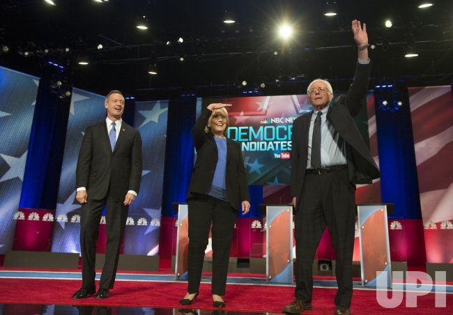 Democratic Presidential Candidates Clinton, Sanders and O'Malley arrive on stage