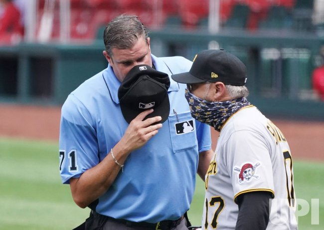 Home Plate Umpire Uses Hat To Cover Mouth