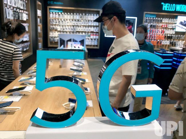 Chinese Look at 5G Smartphones in Beijing, China