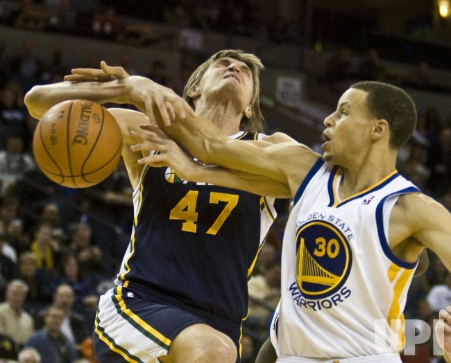 Utah Jazz Andrei Kirilenko is fouled by Golden State Warriors Stephen Curry in Oakland, California