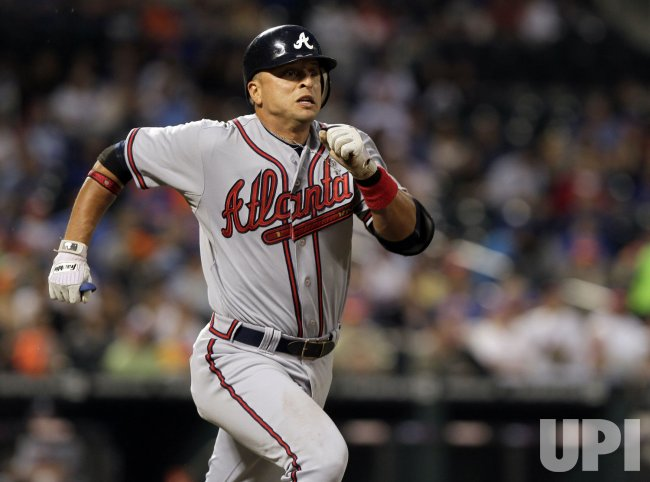 Atlanta Braves Martin Prado runs to first base at Citi Field in New York